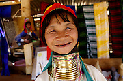 DEMOSO, April 11, 2016 (Xinhua) -- <br /> <br /> A Padaung woman with brass rings around her neck smiles as she stands at her gift shop in Panpet village, Demoso township, Kayah state, Myanmar, April 11, 2016. The brass rings are first applied when the Padaung girls are about eight years old and as the girl grows older, longer coils are added up to 24 or 25 rings. <br /> ©Exclusivepix Media