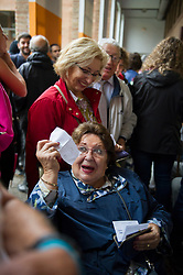 "© Licensed to London News Pictures. 01/10/2017. Barcelona, Spain.  <br /> <br /> A woman shows her vote before votting at Sedeta de Gracia´s Centre Civic.<br /> <br /> Students, their parents, associations and neighbours have organized to carry out ""playful activities"" during the weekend and keep open the Sedeta de Gracia´s Centre Civic.<br />  <br /> Since early in the morning dozens of people wait at the college´s door for the voting time under the rain.<br /> <br /> Mossos d´Escuadra said they won´t do nothing if that can destabilize social order.<br /> <br /> Catalonia is awaiting for today, October 1st, when the Spanish Region wants to vote in a self-determination referendum to get a independence.<br /> <br /> The Referendum´s Law was passed on last September 6th at the Catalonian Parliament thanks to the votes of ""Junts pel Sí"" and ""CUP"". Then it was suspended by the Spanish Constitutional Court, on next day.<br /> Carles Puigdemont, the President of the Government of Catalonia, said he would ignore that and he and his Government will continue with the Referendum.<br /> <br /> The Spanish Government has sent to Catalonia thousands of ""Guardia Civil"" and ""Policía Nacional"" officers (two of the Spanish forces and state security forces), to enforce the ruling of the Constitutional Court and avoid the voting process on next Sunday. They will work with the Mossos d´Escuadra (the Autonomic police in Catalonia).<br /> <br /> To avoid the vote, the Spanish Government has prevented the opening of polling stations, some of which are schools.  <br /> <br /> Photo credit: Gustavo Valiente/LNP"