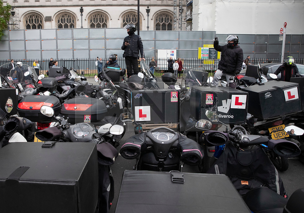VIDEO AVAILABLE https://we.tl/t-mpReKtMDIB © Licensed to London News Pictures. 28/05/2019. London, UK. Food delivery drivers sound their horns and blockade Parliament Square in protest at the murder of a colleague. A 46 year old man has died of his injuries after trying to stop a group of males stealing his moped in Battersea, south west London on Saturday night. Photo credit: Peter Macdiarmid/LNP