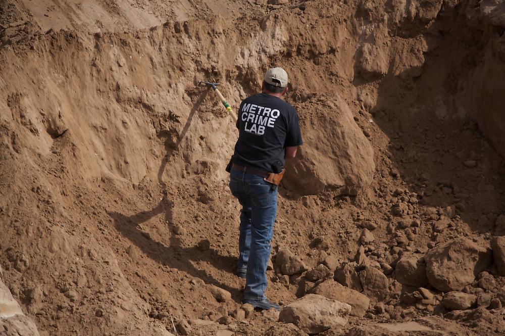 Photo by Steven St. John..Investigators search for additional human remains on Monday, March 2, 2009 on the southwestern outskirts of Albuquerque, N.M. at the site of a planned residential subdivision. Investigators and forensics experts are searching the crime scene where the remains of at least 13 bodies have been uncovered. The discovery has opened up cases involving missing prostitutes, some of whom vanished as much as 20 years ago.