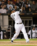 CHICAGO - SEPTEMBER 25:  Welington Castillo #21 of the Chicago White Sox hits a grand slam home run against the Cleveland Indians on September 25, 2019 at Guaranteed Rate Field in Chicago, Illinois.  (Photo by Ron Vesely)  Subject:   Welington Castillo