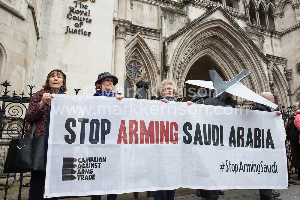 London, UK. 9th April 2019. Human rights activists from Campaign Against Arms Trade (CAAT), Amnesty International UK, Human Rights Watch and Oxfam hold a vigil outside the Royal Courts of Justice before the hearing by the Court of Appeal of CAAT's appeal against a High Court judgment in 2017 which permitted the UK Government to continue to export arms to Saudi Arabia for use in Yemen. The UK has licensed £5 billion of arms to the Saudi military since the attacks on Yemen began in March 2015.