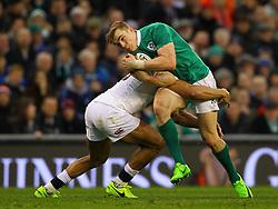 Garry Ringrose of Ireland is tackled by Jonathan Joseph of England - Mandatory by-line: Ken Sutton/JMP - 18/03/2017 - RUGBY - Aviva Stadium - Dublin,  - Ireland v England - RBS 6 Nations
