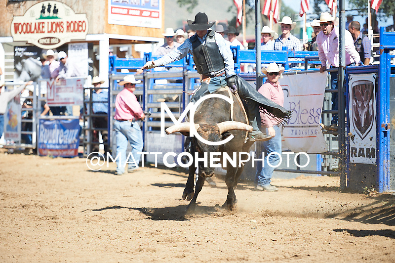 Bull rider Bobby Roberts of Visalia, CA rides Fandango at the Woodlake Lions Rodeo.<br /> <br /> <br /> UNEDITED LOW-RES PREVIEW<br /> <br /> <br /> File shown may be an unedited low resolution version used as a proof only. All prints are 100% guaranteed for quality. Sizes 8x10+ come with a version for personal social media. I am currently not selling downloads for commercial/brand use.