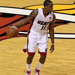 Jun 21, 2012; Miami, FL, USA; Miami Heat point guard Mario Chalmers (15) against the Oklahoma City Thunder during the first quarter in game five in the 2012 NBA Finals at the American Airlines Arena. Mandatory Credit: Derick E. Hingle-US PRESSWIRE