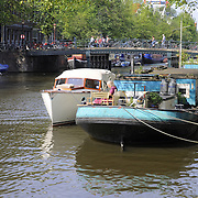 Old boats in canals of Amsterdam, Netherlands