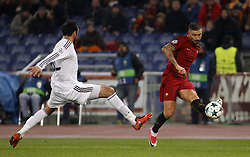 December 5, 2017 - Rome, Italy - Roma s Aleksandar Kolarov, right, is challenged by Qarabag s Elvin Yunuszadae during the Champions League Group C soccer match between Roma and Qarabag at the Olympic stadium. Roma won 1-0 to reach the round of 16. (Credit Image: © Riccardo De Luca/Pacific Press via ZUMA Wire)