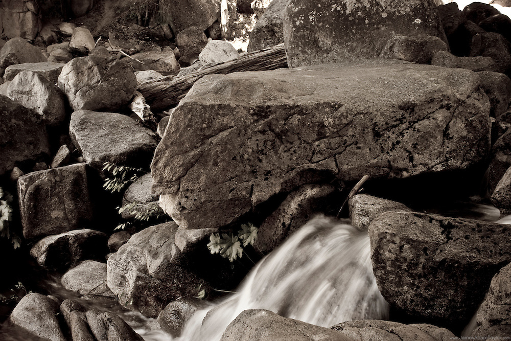 A small stream spills over boulders in California's Yosemite national park