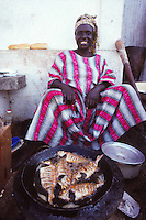woman frying fish in Dakar