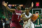 WACO, TX - DECEMBER 17: Kenny Chery #1 of the Baylor Bears drives to the basket against DK Eldridge #1 of the New Mexico State Aggies on December 17, 2014 at the Ferrell Center in Waco, Texas.  (Photo by Cooper Neill/Getty Images) *** Local Caption *** Kenny Chery; DK Eldridge