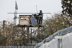 Sipson, UK. 8th March, 2021. Bailiffs from the National Eviction Team (NET) evict residents from the remaining section of a squatted off-grid eco-community garden known as Grow Heathrow. Grow Heathrow was founded in 2010 on a previously derelict site close to Heathrow airport in protest against government plans for a third runway and has since made a significant educational and spiritual contribution to life in the Heathrow villages which are threatened by airport expansion.