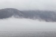 New Windsor, New York - Fog over the icy Hudson River in a view from  Kowawese Unique Area at Plum Point on Jan. 12, 2018.