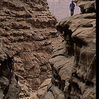 A hiker in Jordan's Wadi Rum navigates the labyrinth of Rakabat Canyon in Jebel (Mount) Um Ishram.