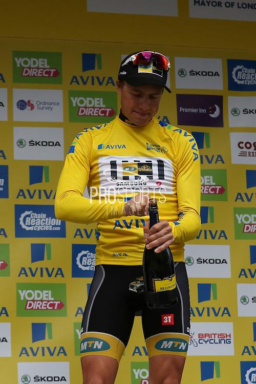 Edvald Boasson Hagen opens the champagne after winning the Aviva Tour of Britain, Regent Street, London, United Kingdom on 13 September 2015. Photo by Ellie Hoad.