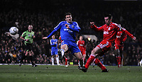 Photo: Tony Oudot/Sportsbeat Images.<br /> Chelsea v Liverpool. Carling Cup, Quarter Final. 19/12/2007.<br /> Jamie Carragher of Liverpool clears from Andriy Shebchenko of Chelsea