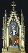 Shrine (Reliquary) of St Ursula, 1489. Gilded, painted wood. Hans Memling (1430/1440-1494) South Netherlandish painter.  End panel of casket showing showing St Ursula (4th century) protecting virgins.   Pilgrimage Christian