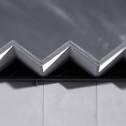 Saw-toothed roof line facade, 1960's era building, modern design in San Diego. Designed by William Rosser.