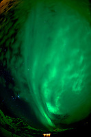 Chasing the Northern Lights. Ersfjord, Kvaløya (Whale Island). Image taken with a Nikon D800 camera and 16 mm f/2.8 fisheye lens (ISO 1000, 16 mm, f/2.8, 15 sec).