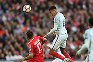 Dele Alli of England heads the ball from a cross. FIFA World cup qualifying match, european group F, England v Malta at Wembley Stadium in London on Saturday 8th October 2016.<br /> pic by John Patrick Fletcher, Andrew Orchard sports photography.