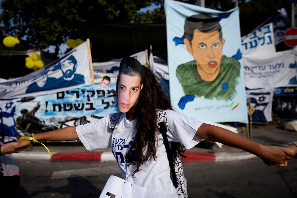 Israelis wear masks bearing the image of Israeli captured soldier Gilad Shalit during a human chain protest in which they circled the Prime Minister's residency in Jerusalem on August 3, 2010, calling for Shalit's release and marking 1500 days since his abduction by Palestinian militants in June 2006.