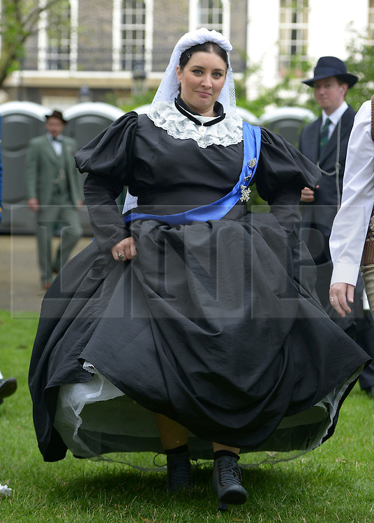 © Licensed to London News Pictures. 07/07/2012. London, UK  A woan dressed as Queen Victoria at 'The Chap's Olympiad' in central London on July 7th, 2012. 'The Chap' is a light-hearted magazine, aimed at revisiting the fashions and pastimes of the polite aspects of 1920's to 1950's England. The annual Olympiad event sees competitors take part in events such the 'Cucumber Sandwich Discus', 'The Umbrella Joust' and 'The Tug of Hair'e. Photo credit : Stephen Simpson/LNP
