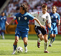 Photo: Chris Ratcliffe.<br /> England v Paraguay. Group B, FIFA World Cup 2006. 10/06/2006.<br /> Steven Gerrard of England clashes with Nelson Valdez of Paraguay.