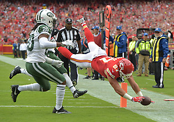 Sep 25, 2016; Kansas City, MO, USA; Kansas City Chiefs tight end Travis Kelce (87) dives in for a touchdown as New York Jets cornerback Marcus Williams (20) attempts the tackle during the first half at Arrowhead Stadium. Mandatory Credit: Denny Medley-USA TODAY Sports