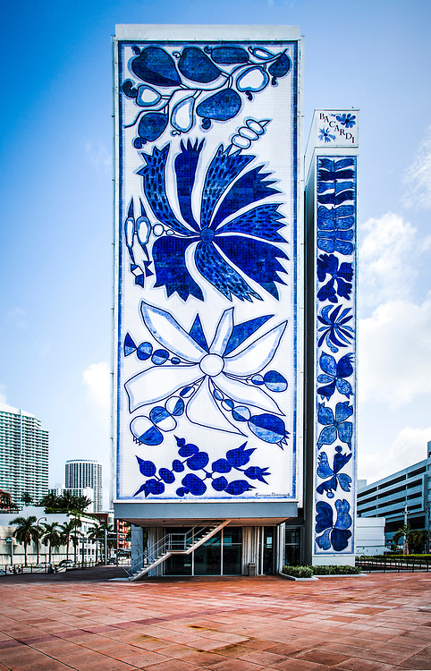 A huge mosaic designed by Brazilian painter and ceramicist Francisco Brennand on the north facade of Miami's Bacardi Tower. The building itself was designed in the Miami Modern (MiMo) style by the Puerto Rican architect Enrique Gutierrez in 1963.