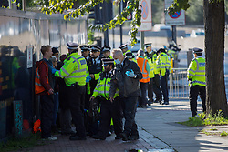 © Licensed to London News Pictures.  04/10/2021. London, UK. Activist from Insulate Britain are arrested as eco-protesters have blocked the A12 Blackwell Tunnel Northern Approach in east London. Photo credit: Marcin Nowak/LNP