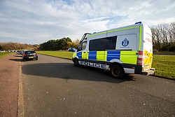 Police van passes the cars parked at Cramond Promenade. Edinburgh on the day after the Lockdown.