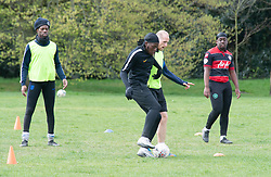 © Licensed to London News Pictures 08/04/2021. Greenwich, UK. Friends meet up for a game of football in Greenwich Park, London as coronavirus lockdown restrictions continue to ease in the UK. Photo credit:Grant Falvey/LNP