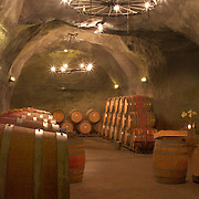 The underground wine cave at the  Gibbston Valley vineyard. The cave has been blasted out of the solid schist of the Central Otago mountains, and creates an ideal natural environment to mature award-winning wines, stored at a constant 12-14°C (53.6-57.2°F). Gibbston Valley Wines, State Highway 6, Queenstown, New Zealand. 23rd March  2011. Photo Tim Clayton