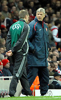 Photo: Ed Godden.<br /> Arsenal v Hamburg. UEFA Champions League, Group G.  Arsenal Manager Arsene Wenger is told to step back from the pitch.