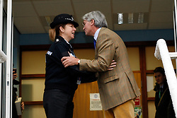 © Licensed to London News Pictures. 20/12/12. Sutton Coldfield, West Midlands, UK. Former Conservative chief whip, Andrew Mitchell kissing Chief Superintendent Lorraine Bottomley as he leaves Sutton Coldfield Police Station after meeting members of the police force. Photo credit : Dave Warren/LNP