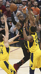 April 29, 2018 - Cleveland, OH, USA - Cleveland Cavaliers' LeBron James looks to pass out of the defense of Indiana Pacers' Bojan Bogdanovic during the first quarter of Game 7 of the Eastern Conference First Round series on Sunday, April 29, 2018 at Quicken Loans Arena in Cleveland, Ohio. The Cavs won the game, 105-101. (Credit Image: © Phil Masturzo/TNS via ZUMA Wire)