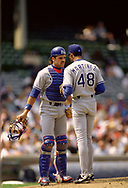 CHICAGO - 1993:  Mike Piazza talks to Ramon Martinez of the Los Angeles Dodgers during an MLB game versus the Chicago Cubs at Wrigley Field in Chicago, Illinois during the 1993 season. (Photo by Ron Vesely) Subject:   Mike Piazza; Ramon Martinez
