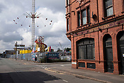 Digbeth fun fair beside the closed down Market Tavern pub on 3rd August 2021 in Birmingham, United Kingdom. Digbeth fun fair offers all sorts of fairground rides and attractions less than a mile from the city centre.