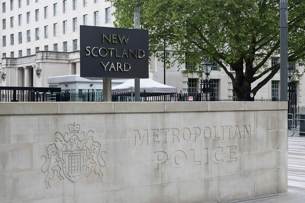The New Scotland Yard sign and building, the headquarters of the the Metropolitan Police, the police force responsible for policing the boroughs of London on the 25th of May 2021, Westminster, London, United Kingdom.  (photo by Andrew Aitchison / In pictures via Getty Images)