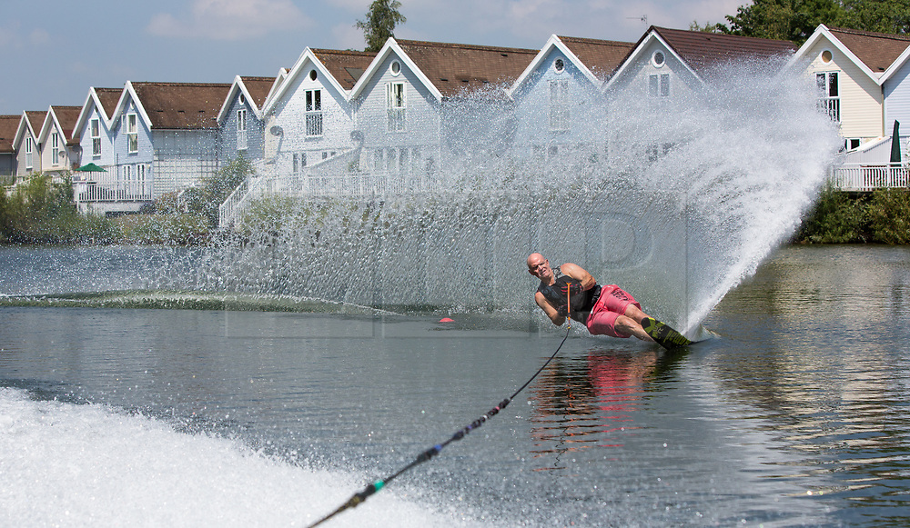 © Licensed to London News Pictures 28/06/2108, Cirencester, UK. Grahame Ramsey enjoying the continued hot weather as he practices his slalom water skiing at the Cotswold Water Park near Cirecenster, Gloucestershire. Photo Credit : Stephen Shepherd/LNP