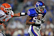 Sept 20, 2008; Lawrence, KS, USA; Kansas Jayhawks wide receiver Dezmond Briscoe (80) catches a 57 yard touchdown pass past Sam Houston State Bearkats safety Jeff Sparks (36) during the second quarter at Memorial Stadium.