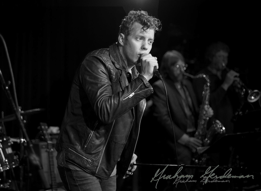 Electric performer Anderson East sings at the Basement in Nashville, TN to a packed house.