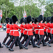 Changing of the Guards at Buckingham Palace 169-111030767x Grenadier Guards march in formation at the Changing of the Queen's Guard ceremony at Buckingham Palace in London.
