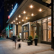 The entrance to The Bartlett in Arlington, Virginia, at night -- exterior design by Maurice Walters Architect