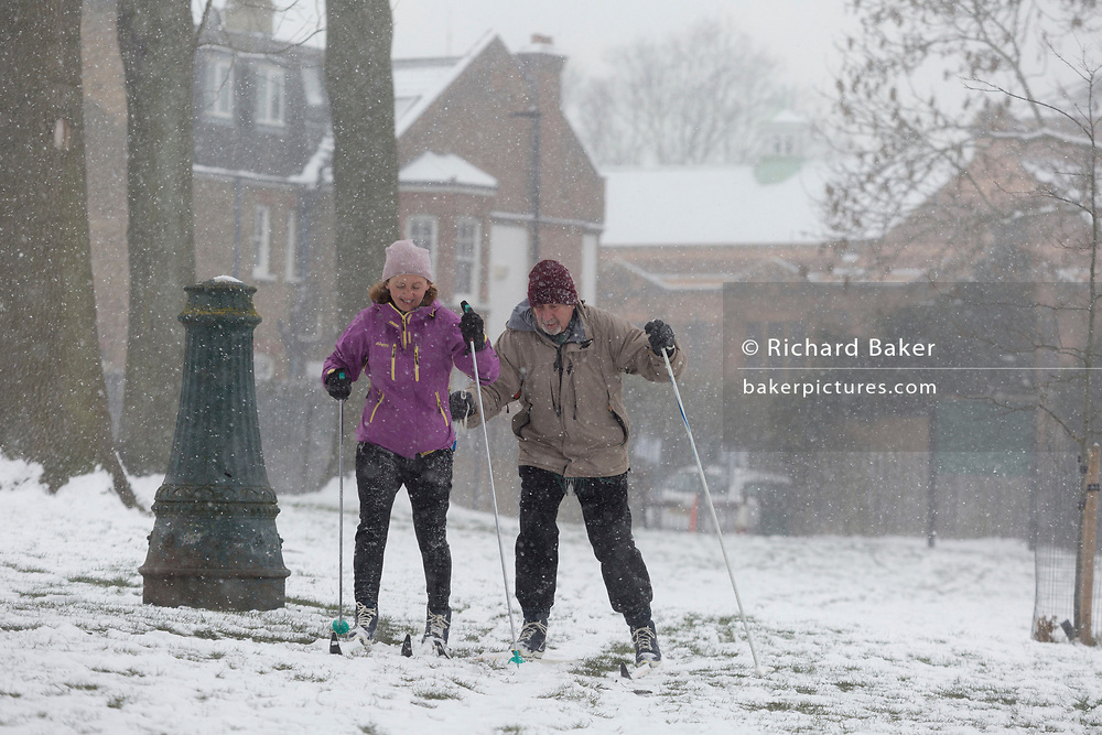 Two cross-country skiers ski through Ruskin Park in Lambeth, during a blizzard in the city, on 28th February 2018, in London, England.