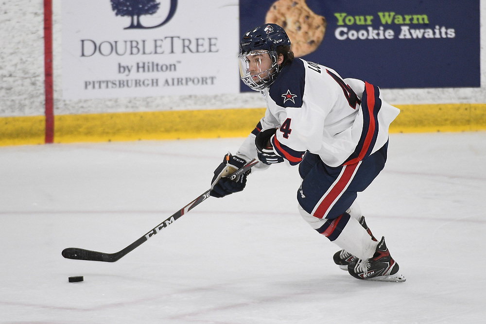 PITTSBURGH, PA - MARCH 12: Tyler Love #4 of the Robert Morris Colonials skates with the puck in the third period during Game One of the Atlantic Hockey Quarterfinal series against the Niagara Purple Eagles at Clearview Arena on March 12, 2021 in Pittsburgh, Pennsylvania. (Photo by Justin Berl/Robert Morris Athletics)