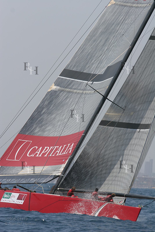 Italy's Capitalia foredeck crew unstows spinnaker as they prepare to round mark during America's Cup international sailing yacht race, Act XI; Valencia, Spain.