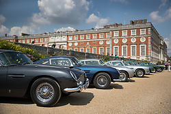 © Licensed to London News Pictures. 02/09/2017. London, UK. Visitors to the Concours of Elegance show admire classic and vintage cars on display in the grounds of Hampton Court Palace. The Concours of Elegance brings together, over three days, a selection of 60 of the rarest cars from around the world some of which have never been seen before in the UK. Each car owner is asked to vote on the other models on display to decide which car is considered to be the 'Best of Show'. The show also displays of hundreds of other fine motor cars, including entrants to The Club Trophy. Photo credit: Peter Macdiarmid/LNP