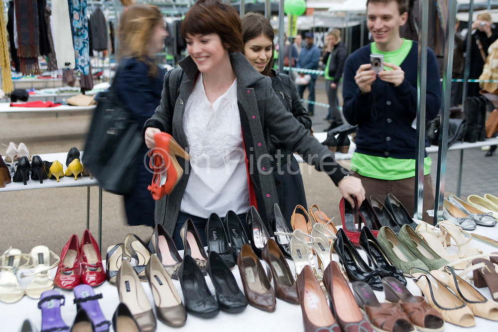 Swishing event held at Spitalfields Old Market in East London. Swishing refers to swapping an item or items of clothing or shoes or an accessory with friends or acquaintances. Parties must willingly give an item to participate in the transaction, once they have given an item they are free to choose something of interest from what others have offered. These events are organised regularly acroos London.