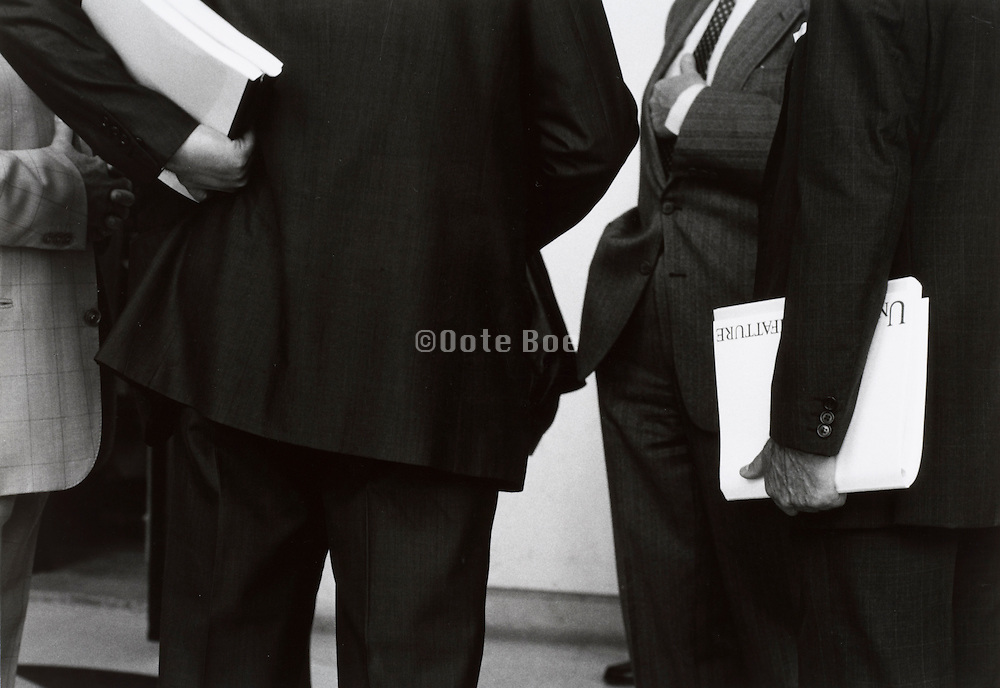 Businessmen holding papers