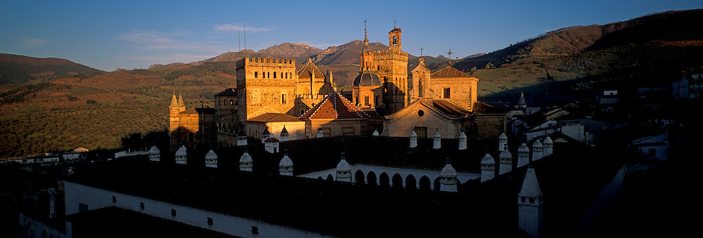SPAIN, EXTREMADURA Monastery of Guadalupe 15th C Mudejar/Gothic style with towers and stork nest, S. W. of Madrid
